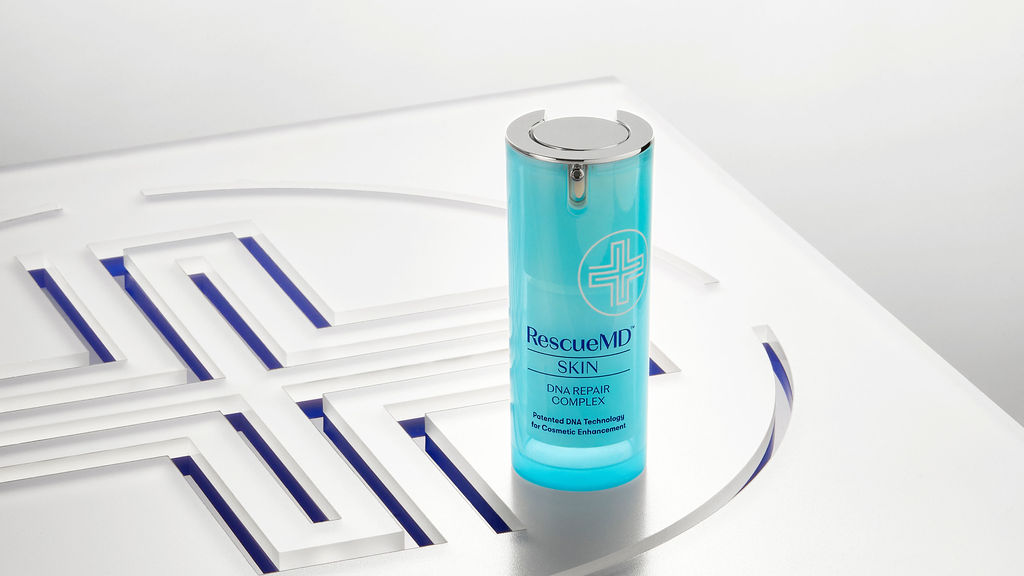 bottle of rescuemd skin dna repair complex on logo surface