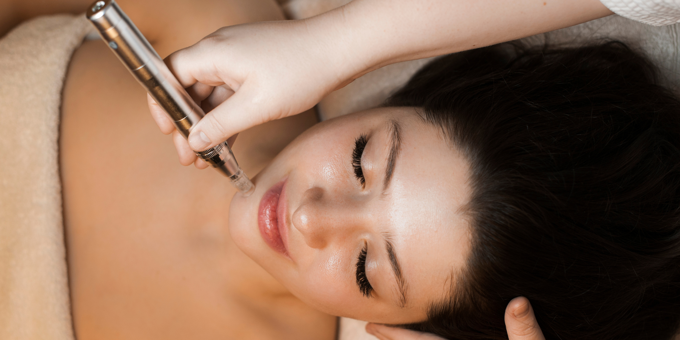Woman relaxing and receiving a professional microneedling treatment